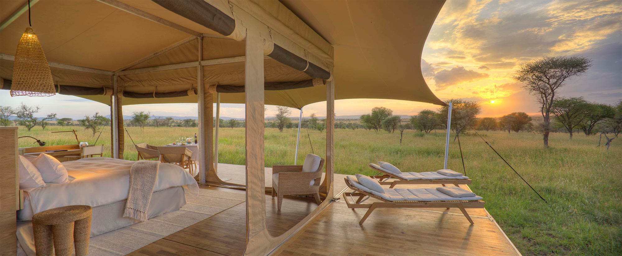 Two lounge chairs on the deck with the Serengeti in the background